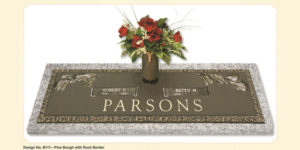 Pine bough design companion bronze marker with a vase